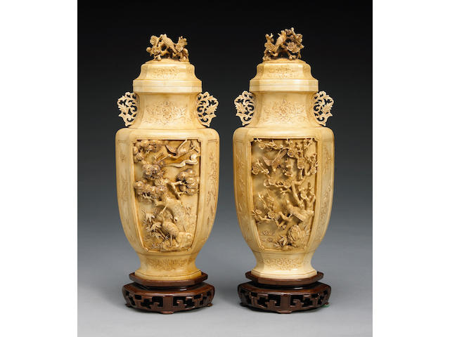 A pair of Chinese carved ivory vases with flowers and trees of the four seasons 20th Century