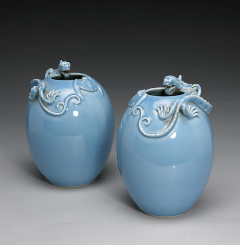 A pair of light blue glazed porcelain vases, molded with qilong, Yongzheng mark, Republic Period