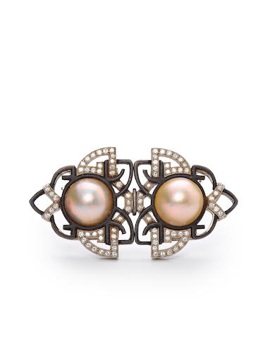 A blackened steel, platinum, diamond and mabe pearl double clip brooch, Marsh