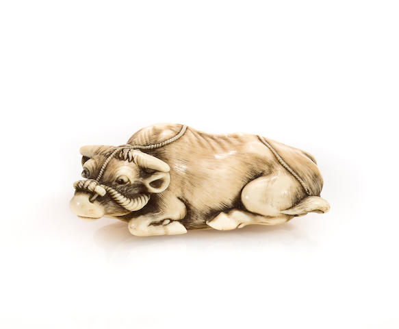 Ivory netsuke of an ox signed Tomotada
