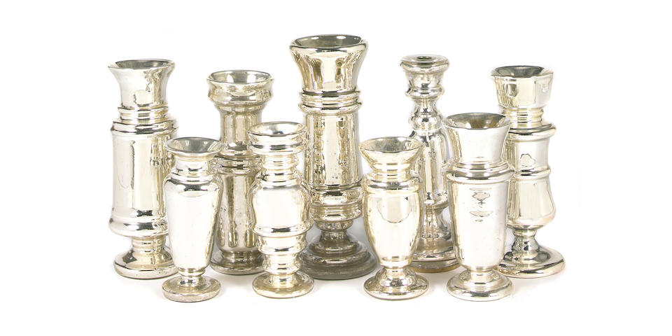 A group of nine Mercury Glass vessels and candlesticks