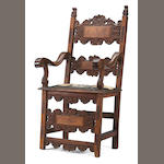 A Spanish Baroque carved walnut inlaid armchair, (appears to retain part of the original leather seat) late 17th/early 18thc.