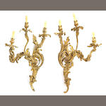 A pair of large Louis XV style gilt bronze three light bras de lumiere, late 19th century