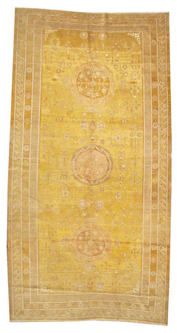 A Khotan long carpet  East Turkestan,  size appoximately 7ft. 11in. x 15ft. 10in.