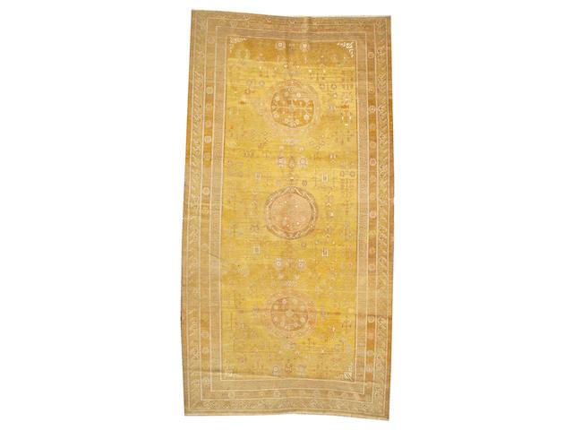 A Khotan long carpet East Turkestan, size appoximately 7ft. 11in. x 15ft. 10in.