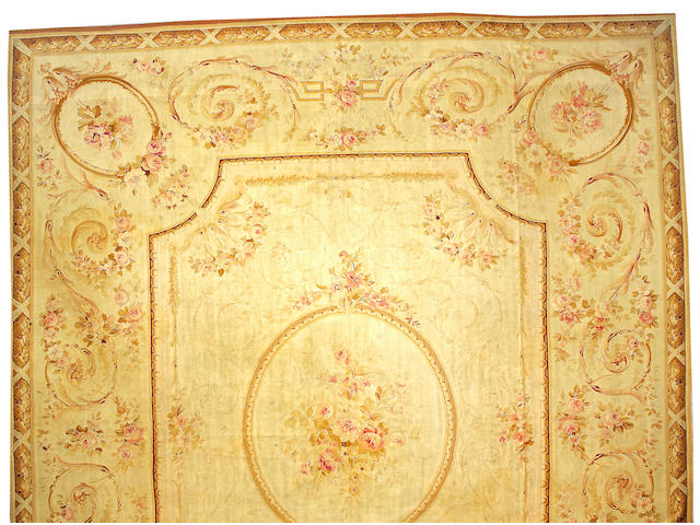 An Aubusson carpet France, size approximately 18ft. x 21ft. 5in.