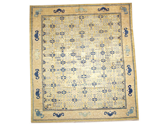 A Chinese carpet with cotton foundation China, size approximately 11ft. 6in.  x 13ft. 2in.