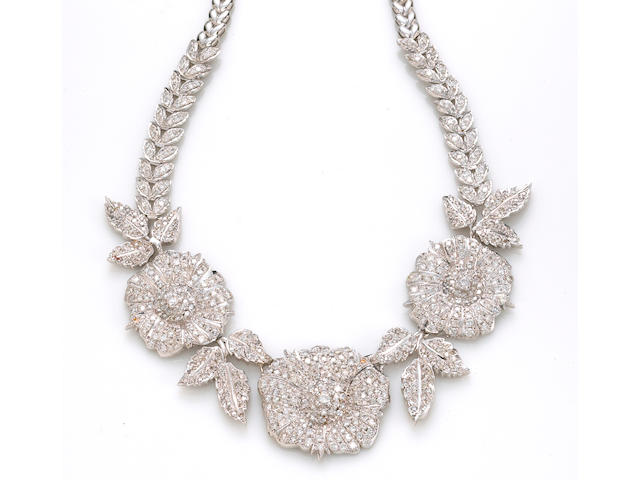 A diamond and white gold floral necklace