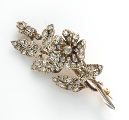 An antique diamond en tremblant brooch,