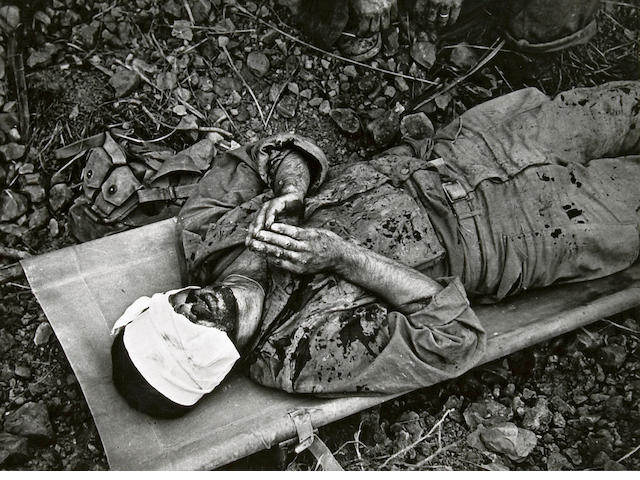 W. Eugene Smith (American, 1918-1978); Wounded Soldier Praying, Okinawa;