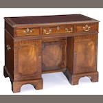 A George III crossbanded mahogany pedestal desk<br>late 18th century
