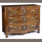 A Louis XV bras mounted walnut commode<br>Lyon<br>mid 18th century