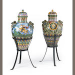 A pair of Italian polychrome mailoica covered jars on iron bases, late 19th century