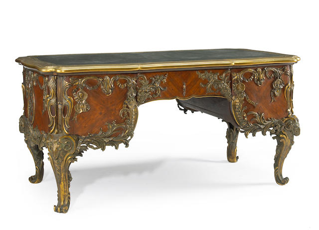 A Louis XV Regency Style Kingwood Gilt Bronze Mounted Tooled Leather Top Bureau Plat, Last quarter 19th century possibly by Henri Dasson.