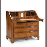 A Continental Baroque walnut slant front desk (Italian or German)