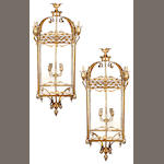 A pair of Renaissance style gilt brass and etched glass lanterns