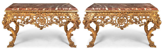 A pair of impressive George II style giltwood console tables