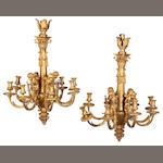 A pair of Louis XVI style gilt bronze eight light chandeliers