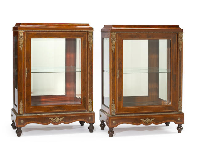 A pair of Napoleon III style bronze mounted inlaid walnut and mahogany vitrine cabinets 20th century