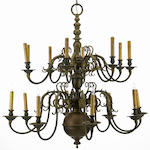 A Dutch Baroque style patinated brass sixteen light chandelier<br>first half 20th century