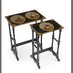 A Victorian parcel gilt ebonized hardwood and papier-mâché nest of two tables<br> third quarter 19th century