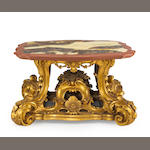 An Italian Rococo style carved giltwood and faux marble table