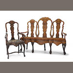 A Dutch Rococo mahogany and marquetry triple back settee with associated chair