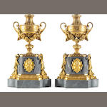 A pair of Louis XVI style gilt bronze mounted gray marble mantel urns, now mounted as table lamps<br>late 19th/early 20th century