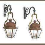 A pair of French Neoclassical copper, iron and glass wall lanterns <br>third quarter 19th century