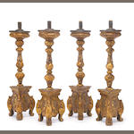 A set of four Portuguese Baroque style polychrome and giltwood prickets<br>late 19th century