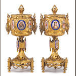 A pair of French Gothic Revival gilt bronze and porcelain inset covered urns <br>second half 19th century
