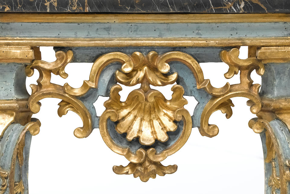 A fine pair of Venetian Rococo parcel gilt and blue painted consoles  third quarter 18th century