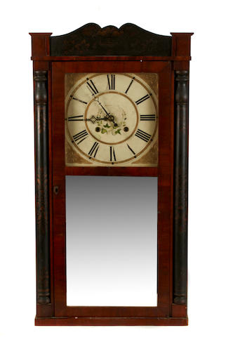 A stencil and paint decorated gilt metal mounted mantel clock