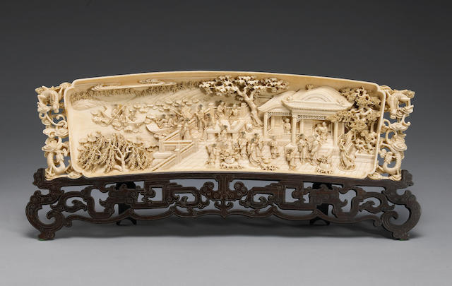 A carved ivory plaque depicting a garden scene 20th Century