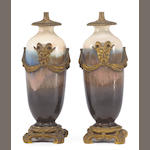 A pair of French gilt bronze mounted flambé porcelain vase form standards<br>early 20th century