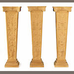 A set of three Renaissance style terracotta pedestals