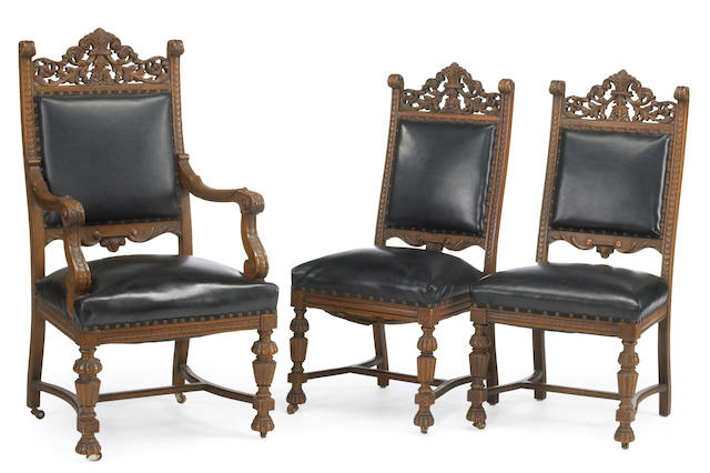 An American Renaissance style ornate carved oak dinning set