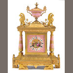 A French Egyptian Revival gilt bronze mounted porcelain mantel clock<br>retailed by Sylvester Hogan, Cleveland, Ohio<br>last quarter 19th century