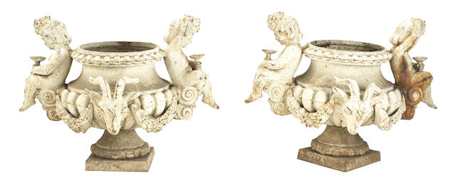 A pair of French Neoclassical painted cast iron figural garden urns<br>fourth quarter 19th century