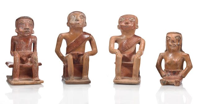 A group of four Carchi seated figures