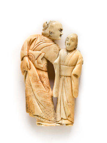 An ivory netsuke of a dandy and courtesan Kyoto, 18th century