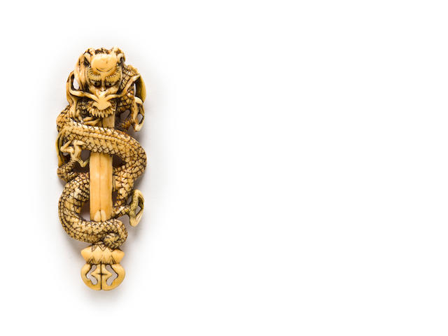 Ivory netsuke of a dragon on a ken, 18th century