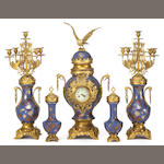 A Belgian gilt brass mounted earthenware five piece clock garniture<br>late 19th century