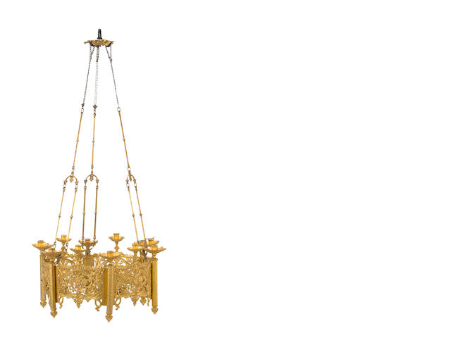 A pair of Gothic style gilt bronze and brass twenty eight light chandeliers