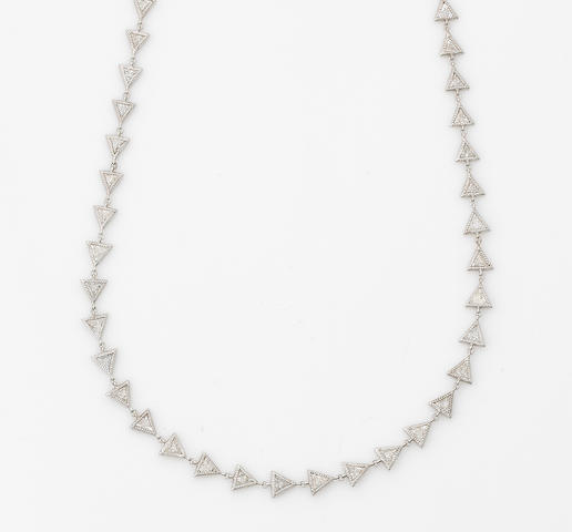 A diamond and eighteen karat white gold link necklace