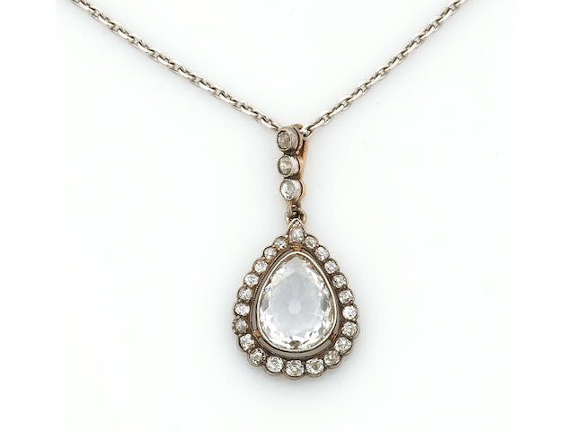 A diamond and silver-topped eighteen karat gold pendant with chain