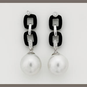 A pair of South Sea cultured pearl, diamond and onyx pendant earrings