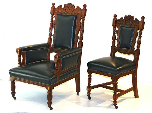 Eight Late Victorian Ornate Carved Black Leather Upholstered Dining Room Chairs, Late 19th century consisting of two armchairs and six side chairs.