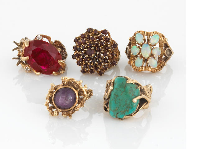 A collection of five stone set and 14k gold rings