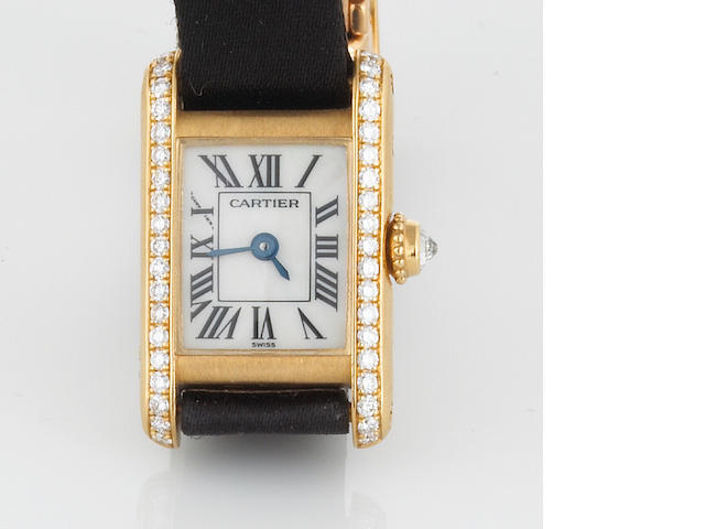 A diamond, mother-of-pearl and gold wristwatch, Cartier, with satin band and box